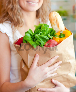 Smiling woman holding a shopping bag