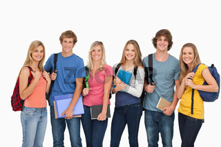 Smiling students all geared up for college