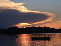 UFO shaped cloud with a sun beam shining trough.