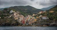 Village of Manarola with colourful houses at the edge of the cliff Riomaggiore,Cinque Terre, Liguria, Italy