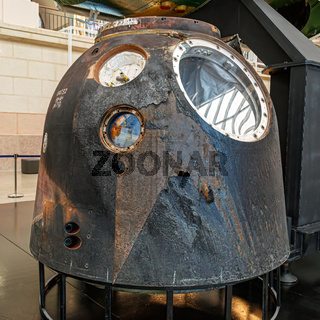 Moscow, Russia - November 28, 2018: Burnt land capsule after returning to the Earth in Space museum. Inside The Cosmonautics and Aviation Centre in the Cosmos pavilion of VDNH. Aircraft exhibition. Rocket science