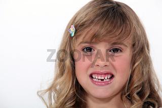 Little girl baring her teeth