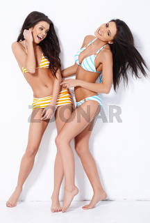 Two cute brunette girl having fun