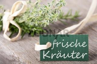 a green label with the german words frische Kräuter which means fresh herbs