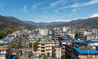 Cityscape of Pokhara with the Annapurna mountain range covered in snow at central Nepal, Asia