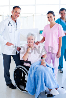 Serious medical team taking care of a senior woman