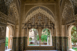view of detailed and ornate Moorish and Arabic decoration in the arched windows of the Nazaries Palace