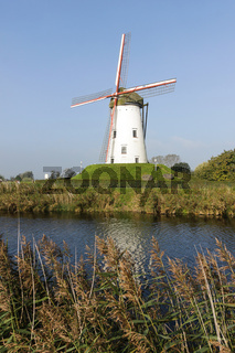 White windmill on canal