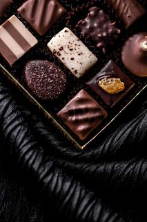 Swiss chocolates in gift box, various luxury pralines made of dark and milk organic chocolate in chocolaterie in Switzerland, sweet dessert food as holiday present and premium confectionery brand