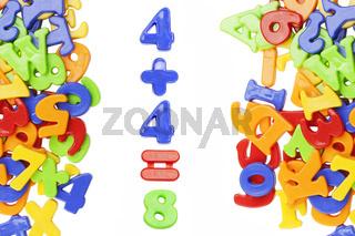 Plastic figures near plastic alphabet letters
