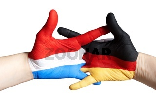 hands symbolizing the relation between dutch and germany