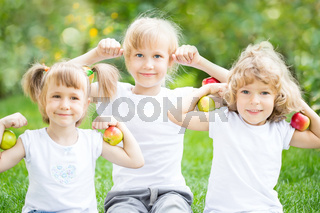 Happy children with apples