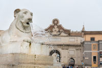 Water through the lion statue head at the Piazza del Popolo , Rome Italy.