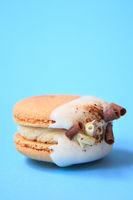 Cake macaron or macaroon on blue background.