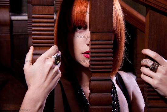 beautiful redhead woman on stairs indoor emotinal