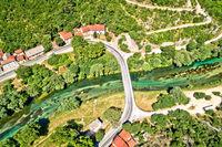 Aerial view of green Krka river bridge in town of Knin