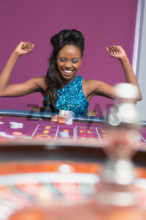 Woman winning at roulette table