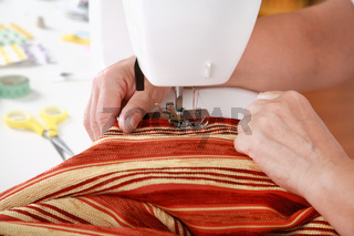 Photo of elderly woman sewing