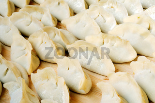 Chinese raw dumplings ready for being boiled
