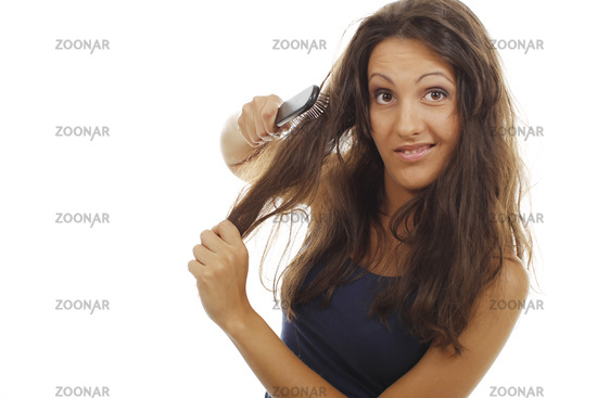 Pretty woman tries to detangle her hairs