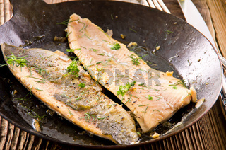 fish fillet fried in the pan