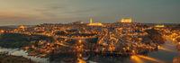 Aerial view illuminated with night street lights Toledo city. Spain