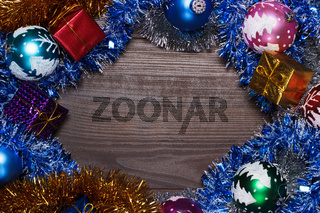 gifts and christmas decoration over wooden background