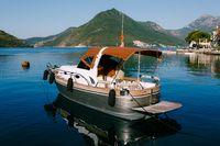 Pleasure motor yacht moored in the town of Perast in Montenegro.