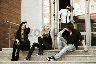 Young people relaxing on the steps