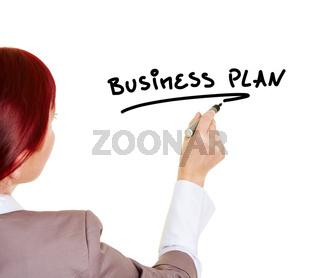 Frau schreibt das Wort Business Plan