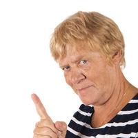 Portrait senior woman with finger on white background
