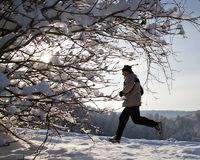 Senior jogging in snow