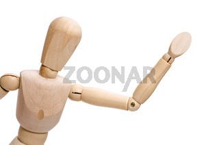 Figur aus Holz tut zur Begrüssung den Arm und die Hand heben