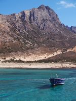 View of Balos Bay with a fishing boat, Crete, Greece