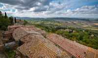 Landscape of Tuscany and house rooftops. Montepulciano hill town, Italy Europe