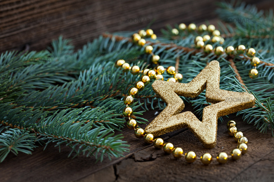 golden star shape on fir