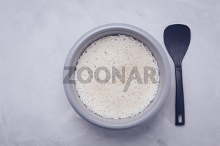 Rice in rice cooker or steamer with spoon
