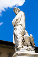 Dante Alighieri statue in Florence, Tuscany region, Italy, with amazing blue sky background.