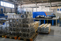 The first phase of metal and aluminum processing. Processed products from CNC machines stacked on a pallet in a large modern factory