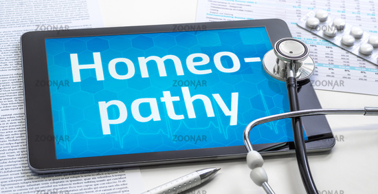 The word Homeopathy on the display of a tablet