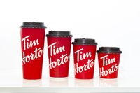 Calgary, Alberta, Canada. May 18, 2021. Tim Hortons coffee cups of different sizes on a white table.