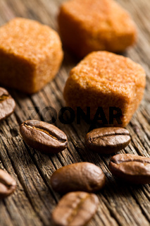 coffee beans with brown sugar cubes