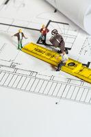 Men work according to a blueprint.