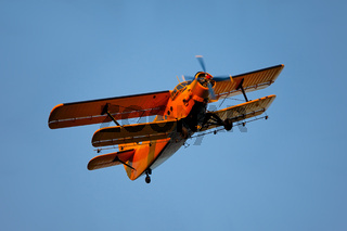 Old airplane against blue sky