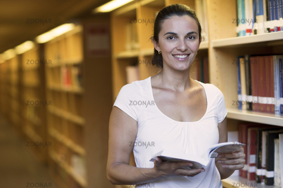 Atractive woman in the library