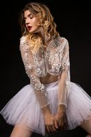 Seductive ballerina in white lacy clothes