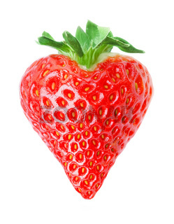 Heart shape red strawberry isolated on white background