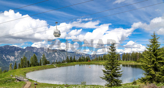 Kleiner See auf der Planai mit Gondelbahn. Smal water reservoir on a mountain by schladming