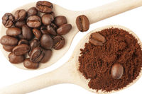 Coffee beans on wooden cooking spoon