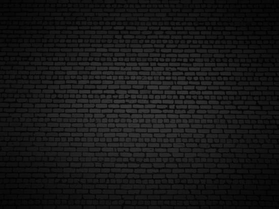 Shaded brick wall texture closeup background.